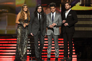 (L-R) Singer Miley Cyrus, musicians Nathan Followill, Jared Followill and Caleb Followill of Kings of Leon speak onstage during The 53rd Annual GRAMMY Awards held at Staples Center on February 13, 2011 in Los Angeles, California.