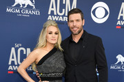 Carrie Underwood and Mike Fisher attend the 54th Academy Of Country Music Awards at MGM Grand Hotel & Casino on April 07, 2019 in Las Vegas, Nevada.