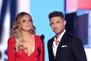 (L-R) Carly Pearce and Michael Ray speak onstage during the 54th Academy Of Country Music Awards at MGM Grand Garden Arena on April 07, 2019 in Las Vegas, Nevada.