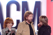 (L-R) Host Reba McEntire and Ronnie Dunn of Brooks & Dunn present the Entertainer of the Year award to Keith Urban onstage during the 54th Academy Of Country Music Awards at MGM Grand Garden Arena on April 07, 2019 in Las Vegas, Nevada.
