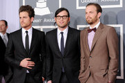 (L-R) Musicians Jared Followill, Nathan Followill and Caleb Followill of the band Kings of Leon arrive at the 54th Annual GRAMMY Awards held at Staples Center on February 12, 2012 in Los Angeles, California.