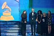 (L-R) Singer/songwriter Lorde and songwriter Joel Little accept the Song of the Year award for 'Royals' with musicians Carole King and Sara Bareilles onstage during the 56th GRAMMY Awards at Staples Center on January 26, 2014 in Los Angeles, California.
