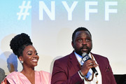 "Teyonah Parris (L) and Brian Tyree Henry speak onstage at the ""If Beale Street Could Talk"" U.S. premiere Q&A during the 56th New York Film Festival at The Apollo Theater on October 09, 2018 in New York City."