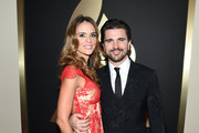 Singer Juanes (R) and actress Karen Martinez attend The 57th Annual GRAMMY Awards at the STAPLES Center on February 8, 2015 in Los Angeles, California.