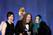 """(L-R) Annie Stoll, """"Weird Al"""" Yankovic and  Meghan Foley pose with their award at the 61st Annual GRAMMY Awards Premiere Ceremony at Microsoft Theater on February 10, 2019 in Los Angeles, California."""
