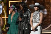 (L-R) Host Alicia Keys, Michelle Obama and Jennifer Lopez speak onstage during the 61st Annual GRAMMY Awards at Staples Center on February 10, 2019 in Los Angeles, California.