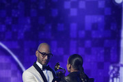 Swizz Beatz (L) and host Alicia Keys speak onstage during the 61st Annual GRAMMY Awards at Staples Center on February 10, 2019 in Los Angeles, California.