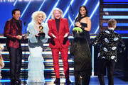 (L-R) Smokey Robinson and music group Little Big Town's Kimberly Schlapman and Philip Sweet of music group Little Big Town present the Song of the Year award for 'Bad Guy'  to Billie Eilish and Finneas O'Connell onstage during the 62nd Annual GRAMMY Awards at STAPLES Center on January 26, 2020 in Los Angeles, California.