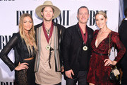 (L-R) Brittney Marie Cole, Brian Kelley and Tyler Hubbard of Florida Georgia Line, and Hayley Stommel attend the 63rd Annual BMI Country awards on November 3, 2015 in Nashville, Tennessee.