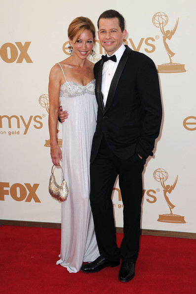 Actor Jon Cryer (R) and TV personality Lisa Joyner arrive at the 63rd Annual Primetime Emmy Awards held at Nokia Theatre L.A. LIVE on September 18, 2011 in Los Angeles, California.