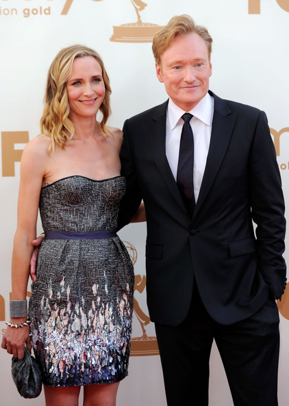 Comedian Conan O'Brien (R) and wife Liza Powel .arrive at the 63rd Annual Primetime Emmy Awards held at Nokia Theatre L.A. LIVE on September 18, 2011 in Los Angeles, California.