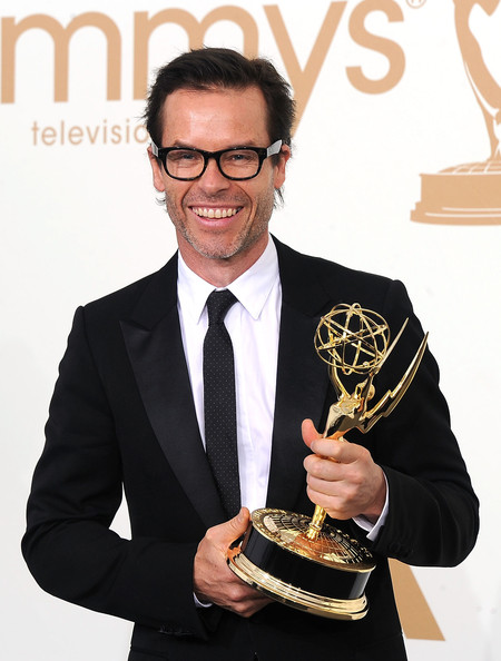 Actor Guy Pearce poses with the award for Outstanding Supporting Actor in a Miniseries or a Movie in the press room during the 63rd Annual Primetime Emmy Awards held at Nokia Theatre L.A. LIVE on September 18, 2011 in Los Angeles, California.