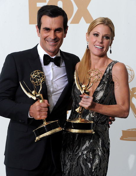 Actor Ty Burrell and actress Julie Bowen of Modern Family pose in the press room after winning outstanding supporting actor and actress in a comedy series 2011 during the 63rd Annual Primetime Emmy Awards held at Nokia Theatre L.A. LIVE on September 18, 2011 in Los Angeles, California.