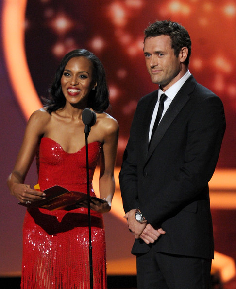 Actors Kerry Washington (L) and Jason O'Mara speak onstage during the 63rd Annual Primetime Emmy Awards held at Nokia Theatre L.A. LIVE on September 18, 2011 in Los Angeles, California.