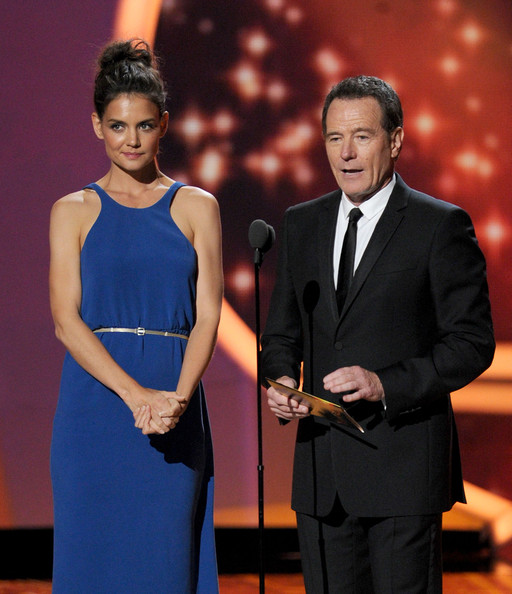 Actors Katie Holmes (L) and Bryan Cranston speak onstage during the 63rd Annual Primetime Emmy Awards held at Nokia Theatre L.A. LIVE on September 18, 2011 in Los Angeles, California.