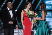 Miss Slovenia 2015, Ana Halozan (C), is welcomed on stage by host Steve Harvey (L) and Miss Universe 2014 Paulina Vega (R) during the 2015 Miss Universe Pageant at The Axis at Planet Hollywood Resort & Casino on December 20, 2015 in Las Vegas, Nevada. Halozan suffered a seizure before the pageant that left the right side of her face paralyzed.