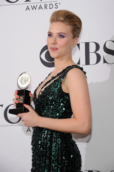 Actress Scarlett Johansson poses with her award for Best Performance by a Featured Actress in a Play at the 64th Annual Tony Awards at The Sports Club/LA on June 13, 2010 in New York City.