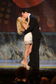 Actors Kristen Chenoweth and Sean Hayes kiss onstage during the 64th Annual Tony Awards at Radio City Music Hall on June 13, 2010 in New York City.