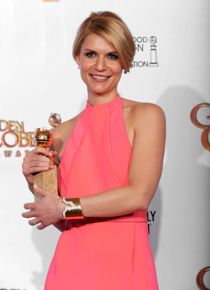 "Actress Claire Danes poses with her award for Best Performance by an Actress in a Mini-Series or Motion Picture Made for Television for ""Temple Grandin"" in the press room at the 68th Annual Golden Globe Awards held at The Beverly Hilton hotel on January 16, 2011 in Beverly Hills, California."