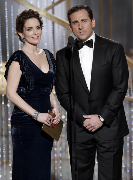 In this handout photo provided by NBC, Presenters Tina Fey (L) and Steve Carell speak onstage during the Golden Globes at the Beverly Hilton International Ballroom on January 16, 2011 in Beverly Hills, California.