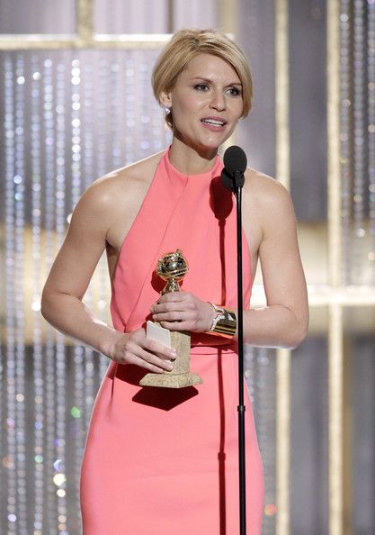 "In this handout photo provided by NBC, Actress Claire Danes accepts the award for Best Actress in a Mini-Series or TV Movie for ""Temple Grandin"" onstage during the Golden Globes at the Beverly Hilton International Ballroom on January 16, 2011 in Beverly Hills, California."