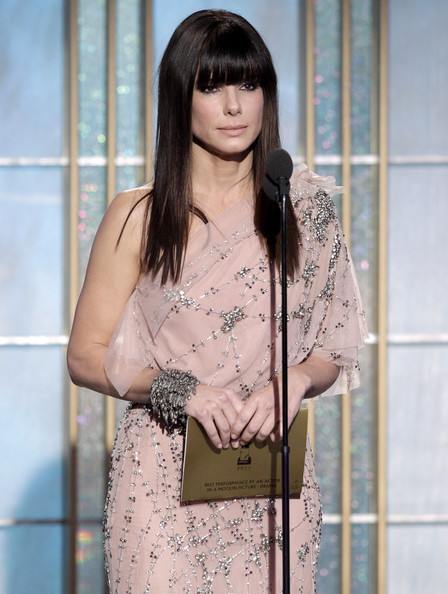 In this handout photo provided by NBC, Presenter Sandra Bullock speaks onstage during the Golden Globes at the Beverly Hilton International Ballroom on January 16, 2011 in Beverly Hills, California.