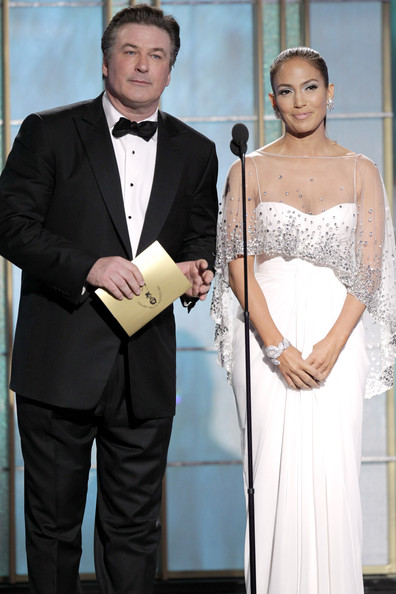 In this handout photo provided by NBC, Presenters Alec Baldwin and Jennifer Lopez speak onstage during the Golden Globes at the Beverly Hilton International Ballroom on January 16, 2011 in Beverly Hills, California.