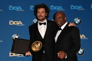 """Australia-born director Garth Davis (L) poses with the award for Best Director in a First Time Feature Film for Lion,"""" and director John Singleton, in the press room at the 69th Annual Directors Guild Awards (DGA), February 4, 2017 in Beverly Hills, California. / AFP / Mark Ralston"""