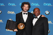 """Director Damien Chazelle (L), recipient of the Feature Film Nomination Plaque for """"La La Land,"""" poses with director John Singleton in the press room during the 69th Annual Directors Guild of America Awards at The Beverly Hilton Hotel on February 4, 2017 in Beverly Hills, California."""