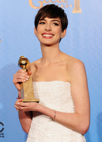 "Actress Anne Hathaway, winner of Best Supporting Actor in a Motion Picture for ""Les Miserables,"" poses in the press room during the 70th Annual Golden Globe Awards held at The Beverly Hilton Hotel on January 13, 2013 in Beverly Hills, California."