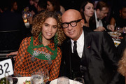 Poet Cleo Wade (L) and Gucci CEO Marco Bizzarri attend the 70th Annual Parsons Benefit on May 21, 2018 in New York City.