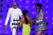 RuPaul (L) and Leslie Jones (R) present award for Lead Actress in a Limited Series to Regina King onstage during the 70th Emmy Awards at Microsoft Theater on September 17, 2018 in Los Angeles, California.