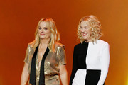 (L-R) Amy Poehler and Catherine O'Hara walk onstage during the 71st Emmy Awards at Microsoft Theater on September 22, 2019 in Los Angeles, California.