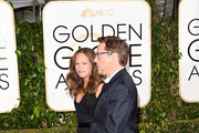 Producer Susan Downey and actor Robert Downey, Jr. attend the 72nd Annual Golden Globe Awards at The Beverly Hilton Hotel on January 11, 2015 in Beverly Hills, California.