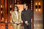 Tina Fey and Jake Gyllenhaal present an award onstage during the 2019 Tony Awards at Radio City Music Hall on June 9, 2019 in New York City.
