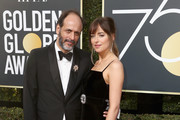 Luca Guadagnino and Dakota Johnson attends The 75th Annual Golden Globe Awards at The Beverly Hilton Hotel on January 7, 2018 in Beverly Hills, California.
