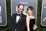 Director Luca Guadagnino (L) and actor Dakota Johnson attend The 75th Annual Golden Globe Awards at The Beverly Hilton Hotel on January 7, 2018 in Beverly Hills, California.