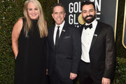 (L-R) Darla K.  Anderson,  Lee Unkrich and Adrian Molina, of the film COCO attend The 75th Annual Golden Globe Awards at The Beverly Hilton Hotel on January 7, 2018 in Beverly Hills, California.