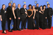 (L-R) Actors Alexis Bledel, O-T Fagbenle, Yvonne Strahovski, Producers Warren Littlefield, Elisabeth Moss, Bruce Miller, actors Samira Wiley, Madeline Brewer, Joseph Fiennes, Ann Dowd, Reed Morano and Max Minghella of 'The Handmaid's Tale' pose with their awards for Best Television Series Drama in the press room during The 75th Annual Golden Globe Awards at The Beverly Hilton Hotel on January 7, 2018 in Beverly Hills, California.