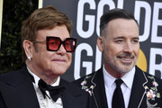 (L-R) Elton John and David Furnish attend the 77th Annual Golden Globe Awards at The Beverly Hilton Hotel on January 05, 2020 in Beverly Hills, California.