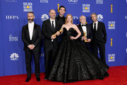 """(L-R) Jeremy Strong, Jesse Armstrong,  Nicholas Braun, Sarah Snook, Alan Ruck, and  Brian Cox pose with the award for BEST TELEVISION SERIES - DRAMA for """"Succession"""" during the 77th Annual Golden Globe Awards at The Beverly Hilton Hotel on January 05, 2020 in Beverly Hills, California."""