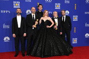 (L-R) Jeremy Strong, Jesse Armstrong, Nicholas Braun, Sarah Snook, Brian Cox, and Alan Ruck pose in the press room during the 77th Annual Golden Globe Awards at The Beverly Hilton Hotel on January 05, 2020 in Beverly Hills, California.