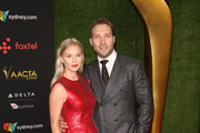 Jai Courtney (R) and Mecki Dent attend the 7th AACTA International Awards at Avalon Hollywood in Los Angeles on January 5, 2018 in Hollywood, California.