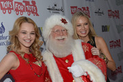 Actress Hunter King (L) and actress Melissa Ordway arrives at the 82nd Annual Hollywood Christmas Parade on Hollywood Blvd. on December 1, 2013 in Hollywood, California.