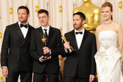Composers Atticus Ross (2nd L) and Trent Reznor (2nd R), winenrs of the award for Best Original Score for 'The Social Network'l, and presenters Hugh Jackman (L) and Nicole Kidman pose in the press room during the 83rd Annual Academy Awards held at the Kodak Theatre on February 27, 2011 in Hollywood, California.