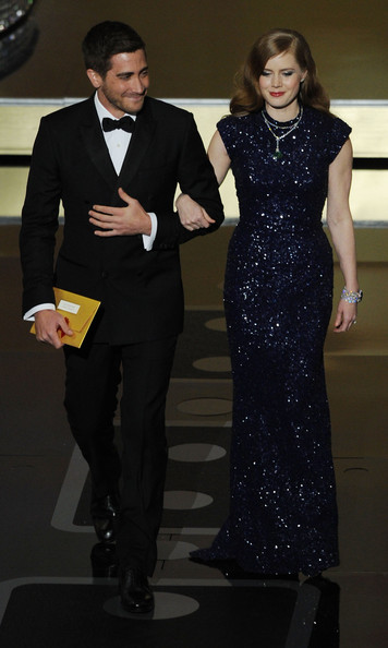 Presenters Jake Gyllenhaal and Amy Adams walk onstage during the 83rd Annual Academy Awards held at the Kodak Theatre on February 27, 2011 in Hollywood, California.