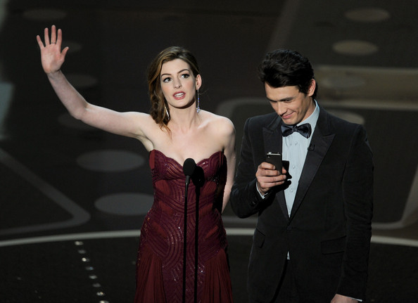 Presenters Anne Hathaway and James Franco speak onstage during the 83rd Annual Academy Awards held at the Kodak Theatre on February 27, 2011 in Hollywood, California.