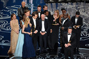 Actor/producer Brad Pitt (lower right) accepts the Best Picture award for '12 Years a Slave' with (back row) actors Sarah Paulson, Benedict Cumberbatch, Lupita Nyong'o, screenwriter John Ridley, actor Chiwetel Ejiofor, producers Arnon Milchan, Dede Gardner, Jeremy Kleiner and Anthony Katagas, actress Adepero Oduye and director Steve McQueen onstage during the Oscars at the Dolby Theatre on March 2, 2014 in Hollywood, California.