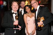 (L-R) Don Hall, Roy Conli and Chris Williams, winners of the Best Animated Feature Award for 'Big Hero 6', and actress Zoe Saldana attend the 87th Annual Academy Awards at Dolby Theatre on February 22, 2015 in Hollywood, California.