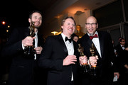 (L-R) Directors Chris Williams and Don Hall, and producer Roy Conli, winners of the Best Animated Feature Award for 'Big Hero 6', attend the 87th Annual Academy Awards Governors Ball at Hollywood & Highland Center on February 22, 2015 in Hollywood, California.